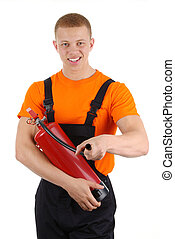 Fire fighter - A worker holding a fire extinguisher,...