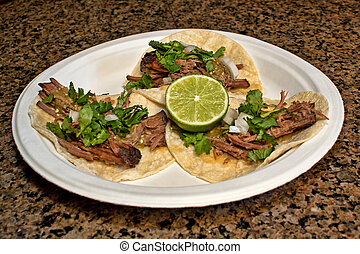 Barbacoa with lime - A plate of barbacoa with cilantro and...