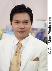 asian groom in wedding suit