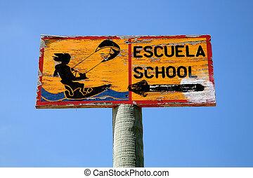 kitesurf school signboard on the beach of Tarifa in Spain