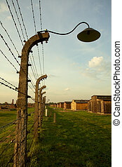 Auschwitz-Birkenau Concentration Camp - Barbed wire fence in...