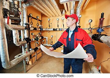 heating engineer repairman in boiler room - maintenance...