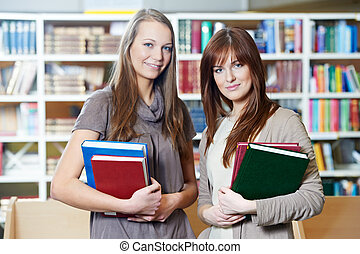 young student girl study with books in library