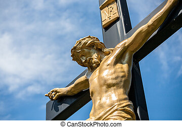 Jesus on a Crucifix - Closeup of a statue of Jesus on a...