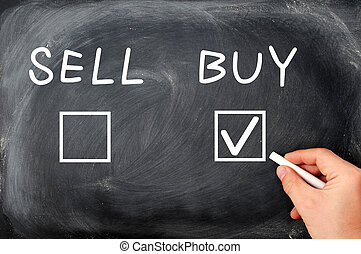 Buy or sell check boxes written on a blackboard