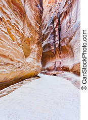 narrow way Siq and water channels to ancient city Petra