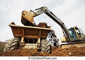 tracked excavator loading the material in a truck