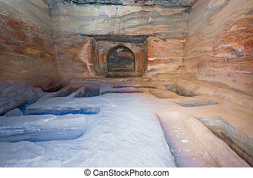 interior of ancient tomb or dwelling in sandstone cave in...