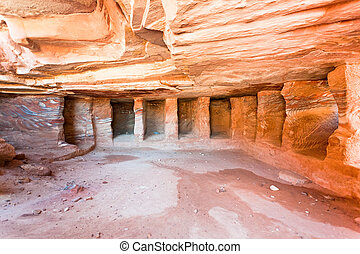 interior of ancient tomb or dwelling in sandstone cavern in Petra