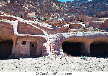 modern bedouin house in ancient cave in Petra