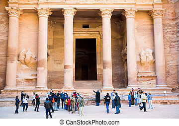 tourists near gate of Treasury Monument in antique city Petra