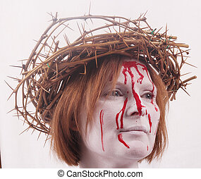 woman - A woman with a white face, crown of thorns and...