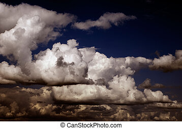 stormy clouds on dark blue sky background