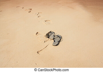 Flip-flops on sand - Flip-flops on the beach sand