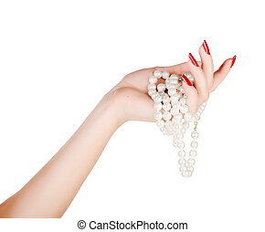 beautiful hand of a young woman with red manicure holding...