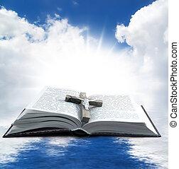 Holy book - Prayer Holy book on the background of clouds and...
