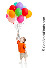 Smiling baby boy with bunch of colorful ballons in his hand...