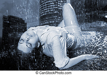 girl under a rain on a background of fires of night city