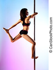 Young pole dance woman on blue and pink background