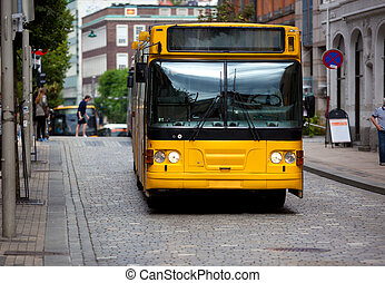 Yellow bus on europe city street.