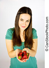 cute female model with strawberries