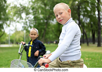 Boy on a bicycle in the green park