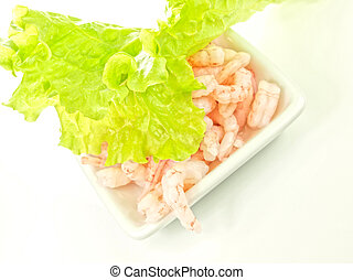 Peeled shrimps, isolated in a white bowl