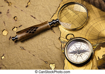 Antique brass compass over old map - Old navigation...
