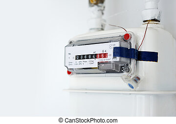 Gas counter on wall - This photograph represents a white...