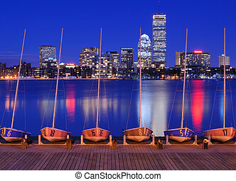 Boston Buildings - Docked boats against the cityscape of...