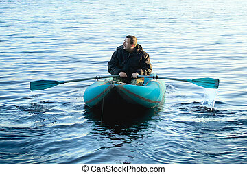 Fisherman in Rubber Boat - fisherman in rubber boat on a...