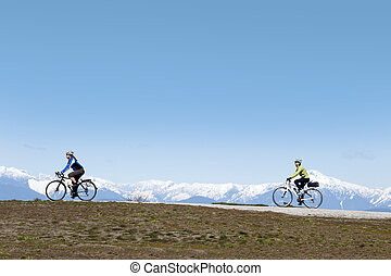 Lady on the bike with mountains