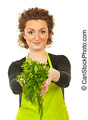 Happy woman gives parsley and dill - Happy redhead woman...