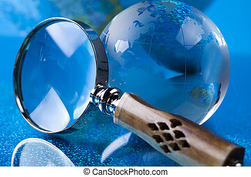 Magnifying glass and globe - Travelling, magnifying glass...