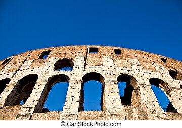 Colosseum with blue sky - Colosseum in Rome with blue sky,...