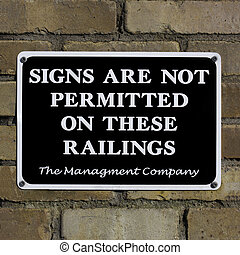 Signs are not permitted on walls - Signs are not permitted...