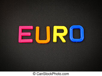 Euro in colorful toy letters on black background
