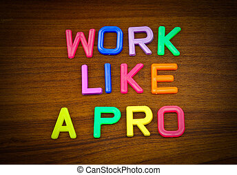 Work like a pro in colorful toy letters on wood background