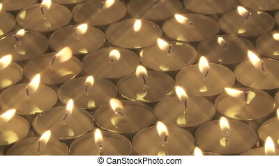 Group of candles - Large number of tea candles rotating past...