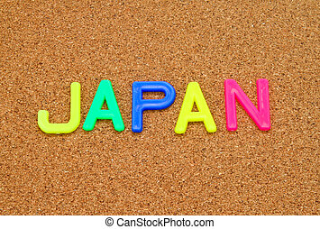 Japan in colorful toy letters on cork background