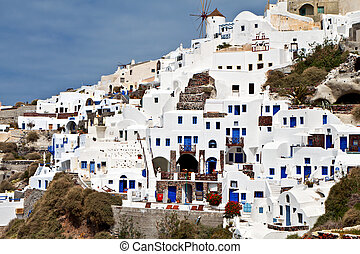 Oia at Santorini island in Greece - Traditional and...