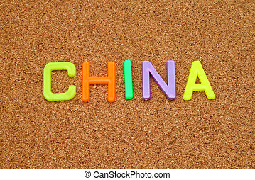 China in colorful toy letters on cork background