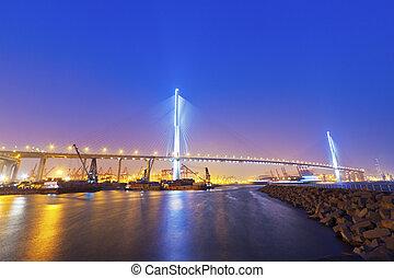 Hong Kong bridge at cargo terminal at night