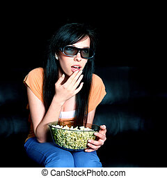Young woman watching 3D TV - Young woman wearing 3D glasses
