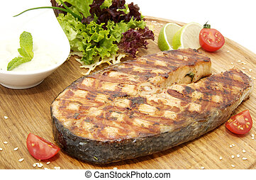 succulent salmon steak cooked on the grill