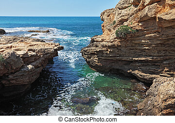 Picturesque sea coast in the early spring. White rocks and...