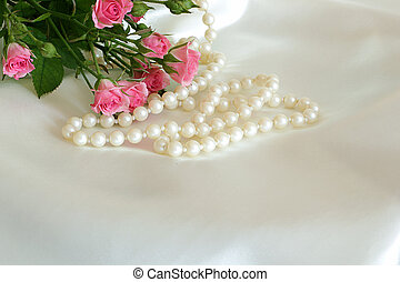 roses and pearls on the white silk
