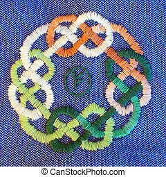 embroidered celtic ornament with rune...