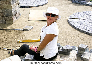 Paving Beauty - Lady with her sun glasses paving the bricks