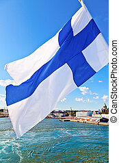 Waving Finnish Flag - Flag of Finland against Helsinki...